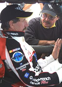 Picture of Dale in the Corvette C5-R racecar discussing strategy.