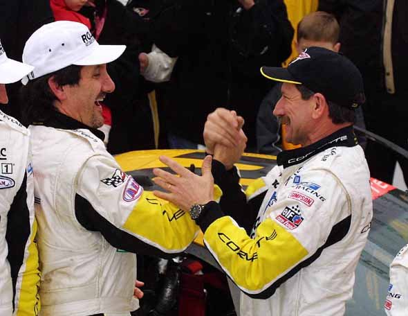 Picture of Dale and Corvette C5-R driver, Ron Fellows sharing a congratulatory handshake upon winning the 2001 Rolex 24 Hours at Daytona race.