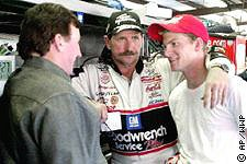 Picture of Dale standing with his arm around Dale Jr.