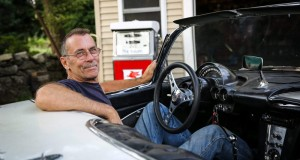 Jeff Taylor and his 1960 Corvette at his home in Hudson on Tuesday. Daily News and Wicked Local Photo/Dan Holmes
