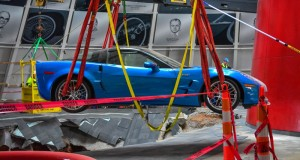 "Workers use a crane to recover the first Chevrolet Corvette, the 2009 Corvette ZR-1 ""Blue Devil,"" from the sinkhole at the National Corvette Museum on Monday, March 3, 2014 in Bowling Green, Kentucky. The vehicle, along with seven other Corvettes, fell into the sinkhole February 12. The ZR-1 appears to have sustained minimal damage after its nearly 30-foot fall. The ""Blue Devil"" started up and drove out of the museum under its own power. (Photo by Adam Boca for Chevrolet)"
